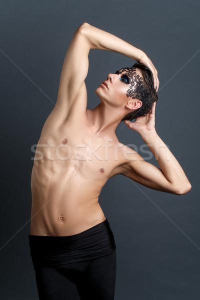 Przystojny młody człowiek koronki twarz czarny studio Zdjęcia stock © svetography