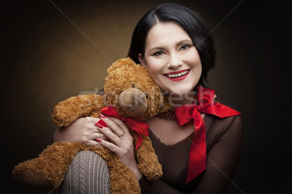 Stock photo: Woman with teddy bear