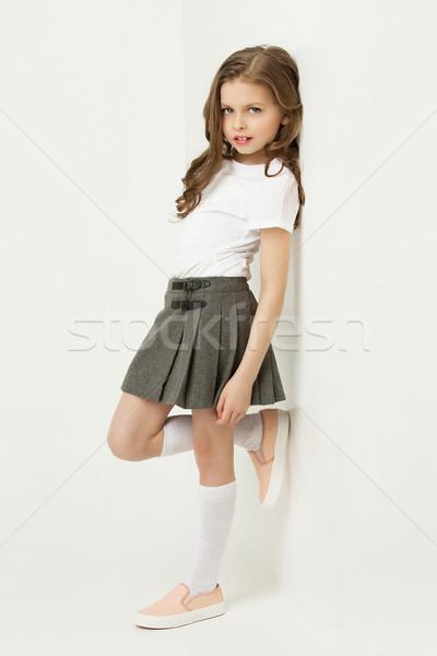 Küçük kız güzel etek ayakta beyaz duvar Stok fotoğraf © svetography