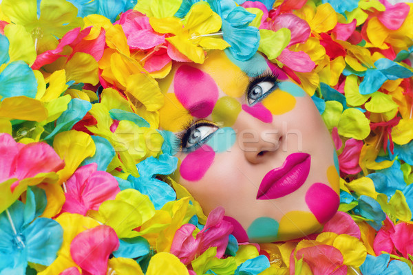 Girl face in flower petals Stock photo © svetography