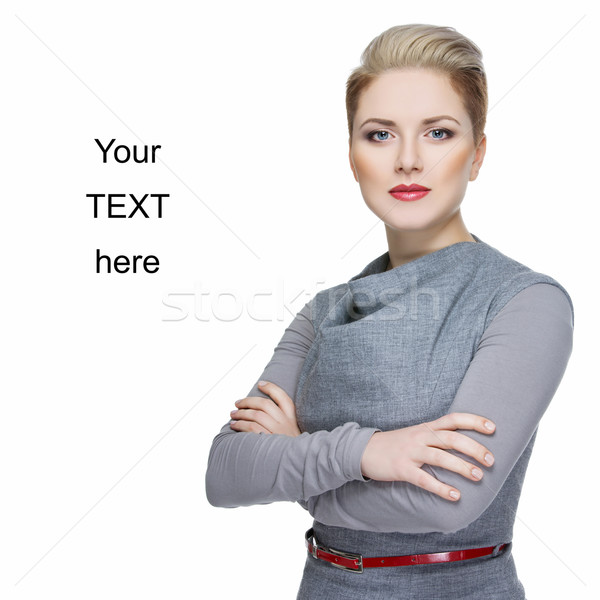 üzletasszony gyönyörű fiatal szürke ruha izolált Stock fotó © svetography