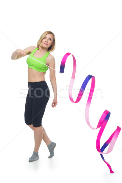 Beautiful woman doing sport exercise with gymnastic ribbon Stock photo © svetography