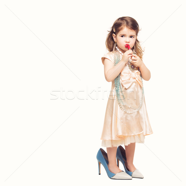 Pequeno menina batom vermelho belo vestir Foto stock © svetography