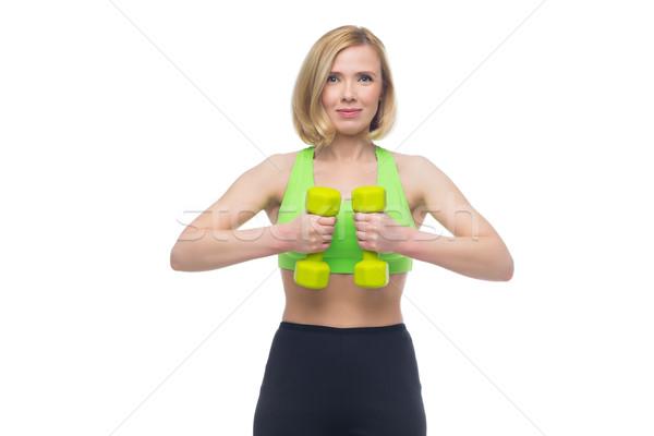 Mujer hermosa deporte ejercicio pesas hermosa Foto stock © svetography