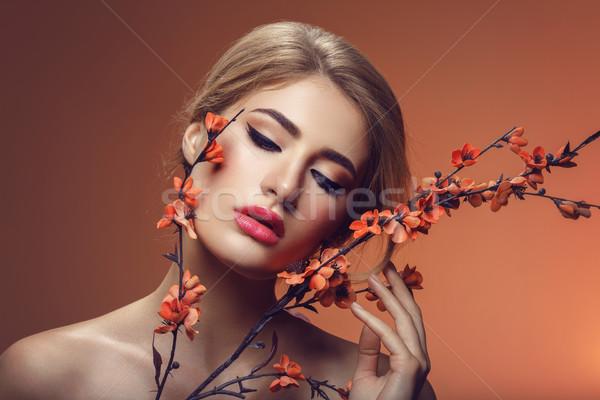 Beautiful girl with sakura branch Stock photo © svetography