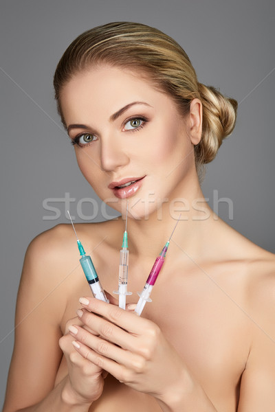 beautiful girl holding syringes Stock photo © svetography