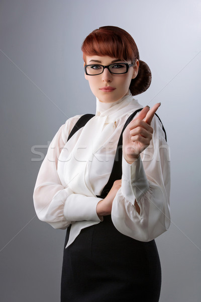 Young woman wagging finger Stock photo © svetography