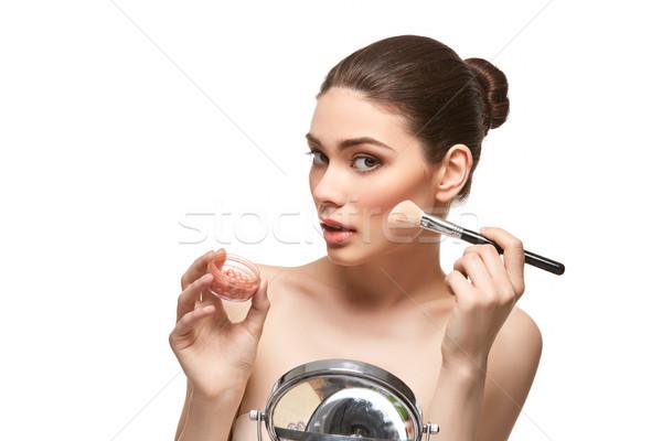 Lány jelentkezik bőrpír arc izolált fehér Stock fotó © svetography