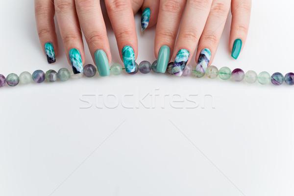 Femme mains coloré clous Creative Photo stock © svetography