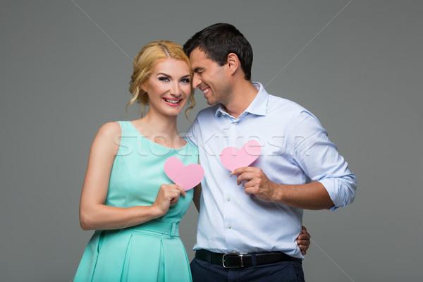 Beautiful couple holding pink hearts Stock photo © svetography