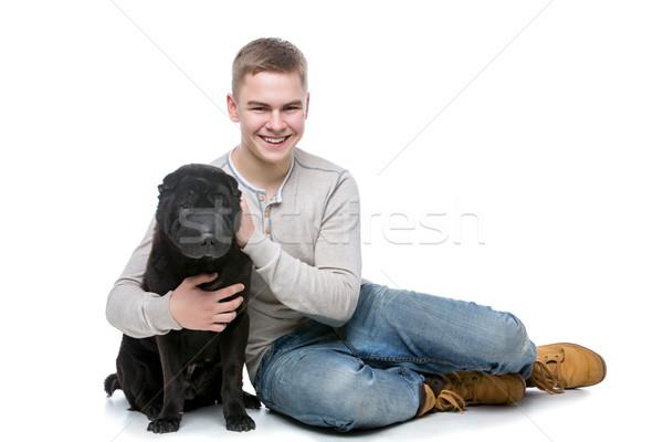 Boy with shar pei dog Stock photo © svetography