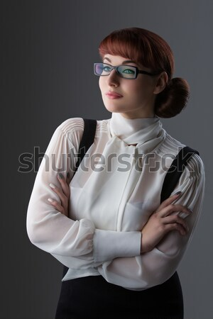 Stock photo: Young woman in glasses