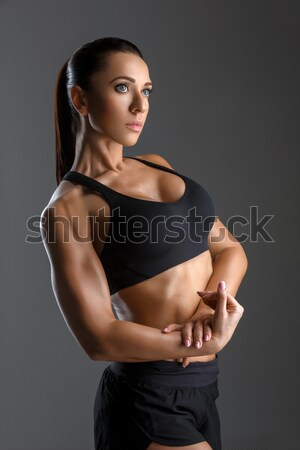 Beautiful fit girl in sport bra and shorts Stock photo © svetography