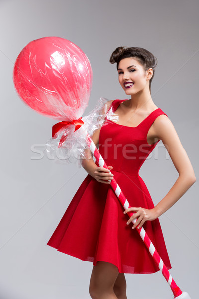Fille robe rouge énorme lollipop belle jeune femme Photo stock © svetography