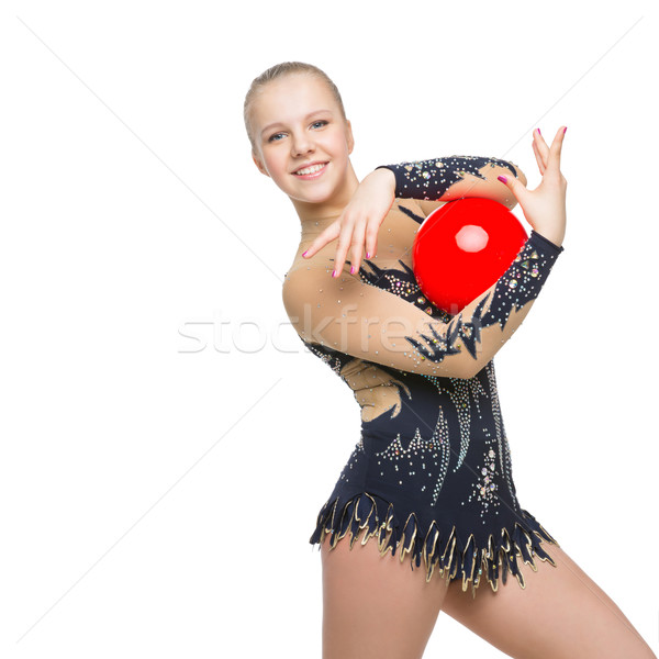 Beautiful gymnast girl with red ball Stock photo © svetography