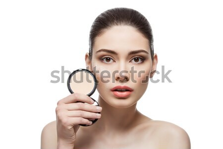 Girl with pressed powder in hand Stock photo © svetography