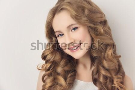 Kız uzun kıvırcık saçlı güzel genç kız beyaz Stok fotoğraf © svetography