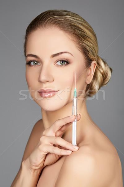 beautiful girl holding syringe Stock photo © svetography