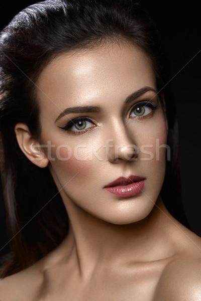 Beautiful girl with cat eye liner makeup Stock photo © svetography