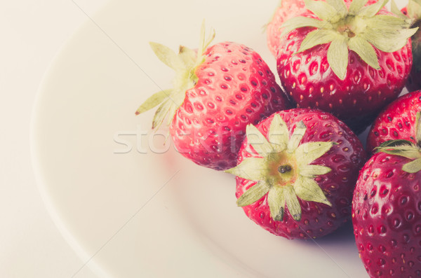 Stawberry on the white dish Stock photo © sweetcrisis