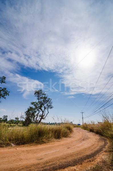 Camino de grava rústico Tailandia cielo azul nubes carretera Foto stock © sweetcrisis