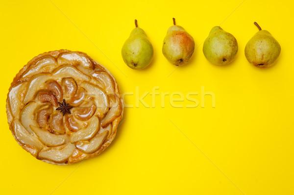 Whole tarte Tatin pear tart with pears on yellow background Stock photo © szabiphotography