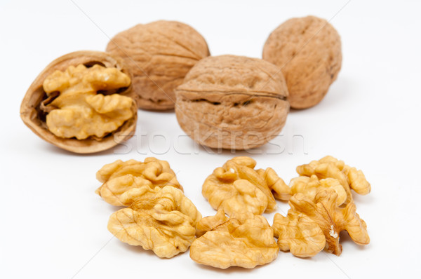 Walnuts and walnut kernels on white background Stock photo © szabiphotography