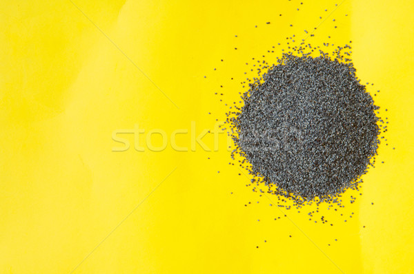 Poppy seeds isolated on yellow background poppy seed Stock photo © szabiphotography