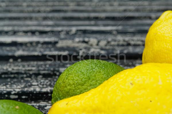 Surowy czarny tle cytryny wapno Zdjęcia stock © szabiphotography