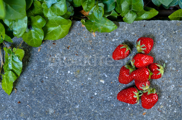 Delicious ripe strawberry  on  grey stone flat lay Healthy fruit Stock photo © szabiphotography
