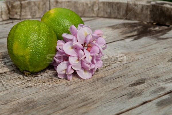 Raw textured wooden Background backdrop with Robinia flower and lime Stock photo © szabiphotography