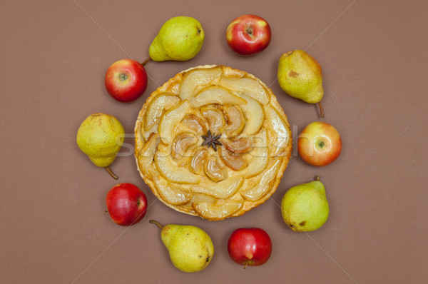 Tarte Tatin apple pear tart with fruits on brown background Stock photo © szabiphotography