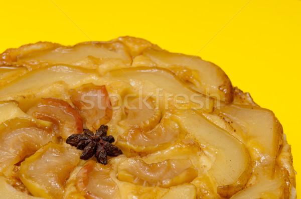 Tarte Tatin apple pear tart isolated on yellow background Stock photo © szabiphotography