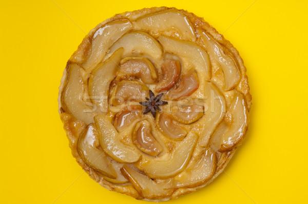 Whole tarte Tatin apple pear tart isolated on yellow background Stock photo © szabiphotography