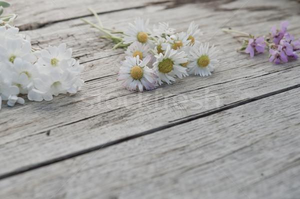Küçük çiçekler ahşap bo yüzey Stok fotoğraf © szabiphotography