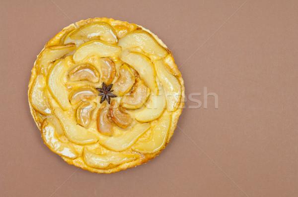 Whole tarte Tatin apple pear tart isolated on brown background Stock photo © szabiphotography