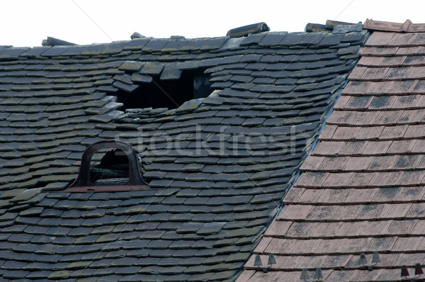 Damaged tiled roof broken leaked Stock photo © szabiphotography