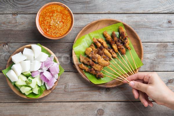 People eating satay Stock photo © szefei