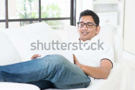Indian male using internet Stock photo © szefei