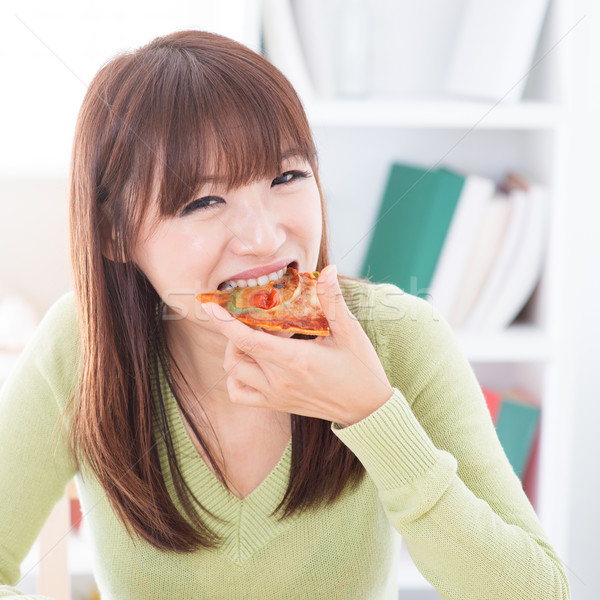 Girl eating pizza Stock photo © szefei