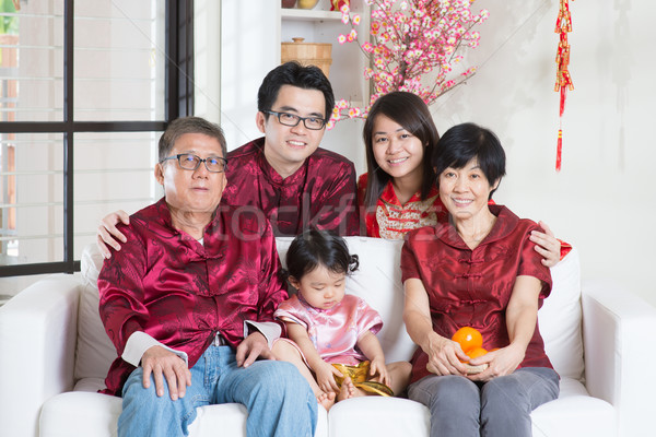 Chinese New Year with family Stock photo © szefei