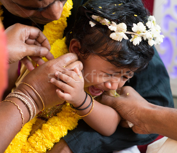 Traditional Indian family ear piercing ceremony Stock photo © szefei