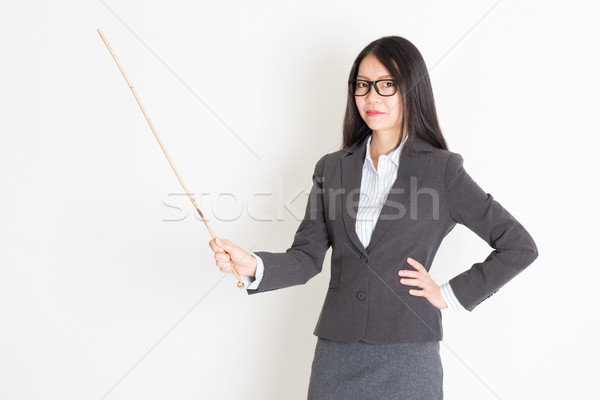 Teacher with cane Stock photo © szefei