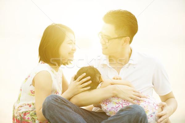 Family enjoying outdoor quality time Stock photo © szefei
