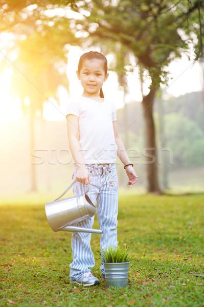 Asian kid Bewässerung Anlage Freien Porträt Stock foto © szefei