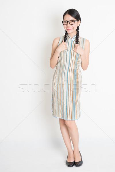 Asian Chinese girl in traditional cheongsam  Stock photo © szefei
