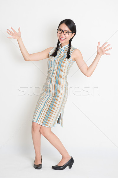Surprised Asian Chinese female open arms  Stock photo © szefei
