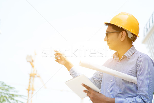 Asian Indian male contractor engineer working Stock photo © szefei