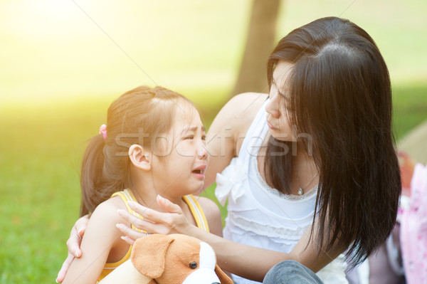 Mother comforting crying child. Stock photo © szefei
