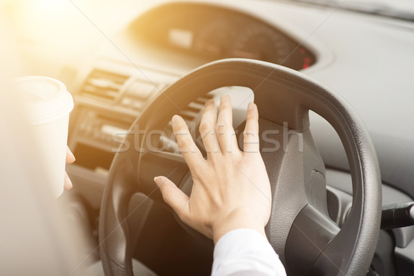 Human hand on steering and honking Stock photo © szefei